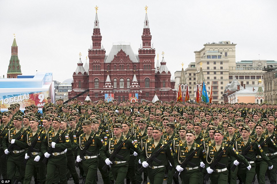 About 10,000 soldiers participated, standing rigidly as Defense Minister Sergei Shoigu reviewed them while standing in an open-top limousine