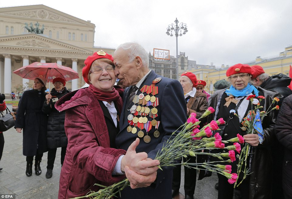 Two Second World War veterans dance at a traditional meeting point near Bolshoi Theatre in Moscow today