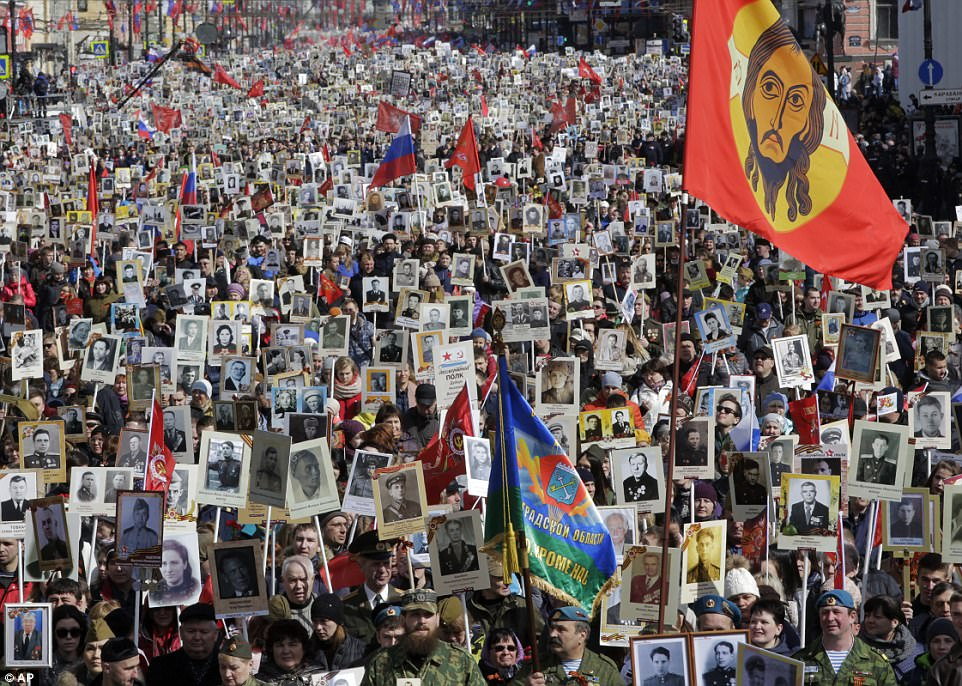 There were similar scenes in St Petersburg, Russia when an estimated 400,000 people walked through the streets carrying pictures of relatives killed in the Second World War