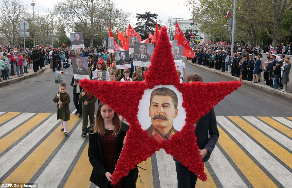 People in Sevastopol, Crimea, carry portraits of late Soviet leader Joseph Stalin and World War Two soldiers during the Immortal Regiment march as they celebrate the 72nd anniversary of the Soviet Union's victory over Nazi Germany