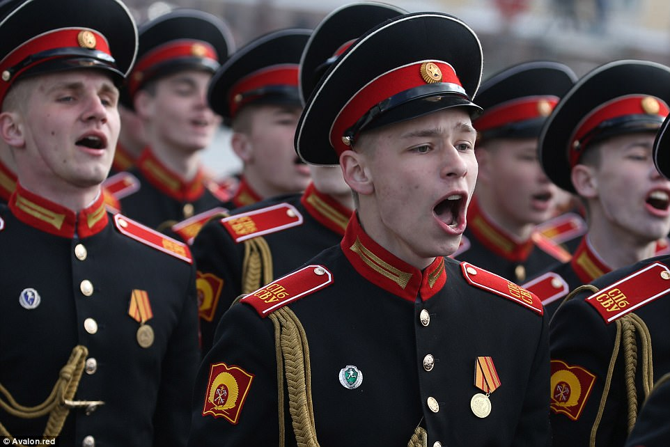 Cadets from the Saint Petersburg Suvorov Military School march and sing in the city's Palace Square during a Victory Day parade