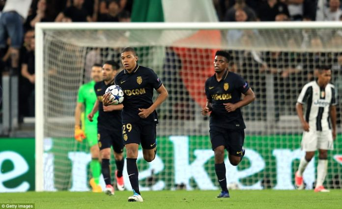 Kylian Mbappe sprints back to the halfway line after netting a second half consolation for Monaco