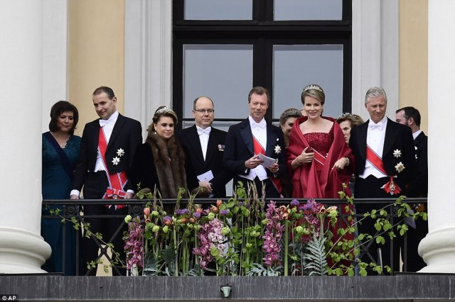 Iceland's first lady Eliza Reid, Iceland's president Gudni Johannesson, Grand Duchess Maria Teresa of Luxembourg, Prince Albert II of Monaco, Grand Duke Henri of Luxembourg, Queen Mathilde of Belgium and King Philippe of Belgium look on at the crowds who have gathered