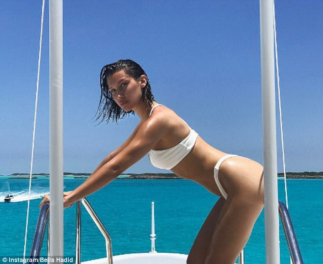 Stunning: The brunette beauty went on to share another saucy snap of her aboard a boat in her skimpy white two-piece