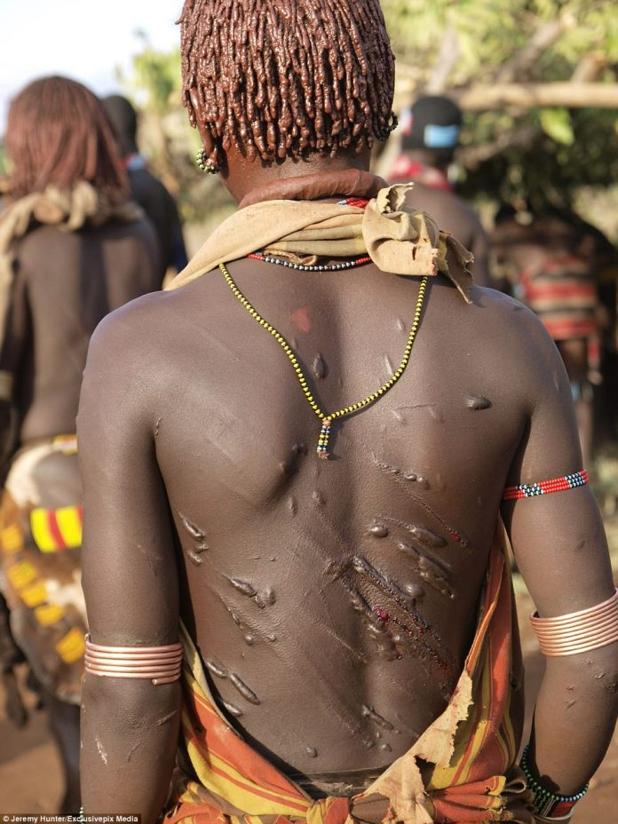 A woman's body carries the injuries from the whipping, carried out by a Maza from the tribe, and he scars are said to demonstrate her capacity for love. The brutal tradition happens at Rite of Passage ceremonies for tribal men