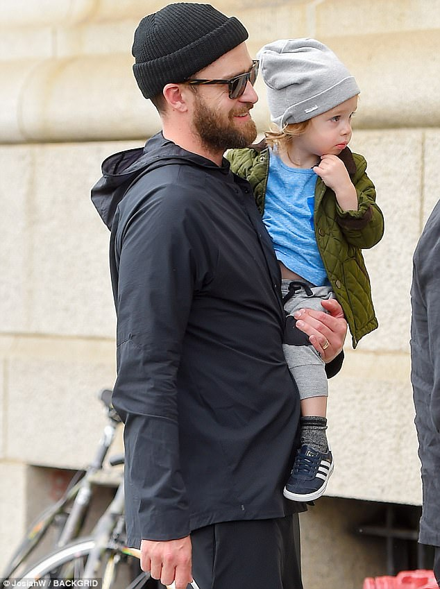 chair exercise justin timberlake potty chairs for girls out with silas and jessica biel in nyc daily father son carried his on thursday after a workout