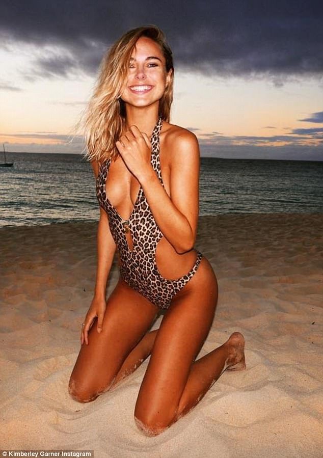 Holiday snap: Kimberley Garner posted a throwback photo in a cut-out leopard print swimsuit on a white sand beach in idyllic Anguilla on Thursday as she pined for her recent trip
