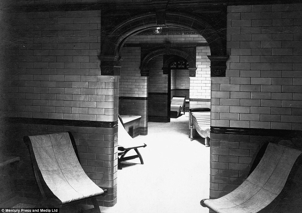 This image from the mid 1900s shows a row of deck chairs places along the tiled arches