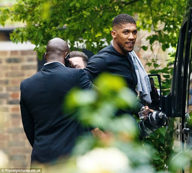 Grounded boxing star Anthony Joshua has moved back into his mother's two-bed ex-council flat (pictured there yesterday) despite earning an estimated £15million from defeating Wladimir Klitschko