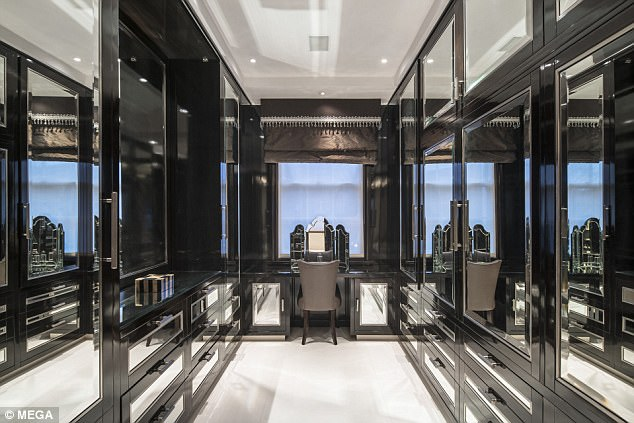 The £86,000-a-month rented mansion includes a large mirrored dressing room