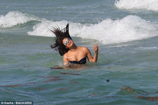 Making a splash: She did an impressive hair whip in the ocean