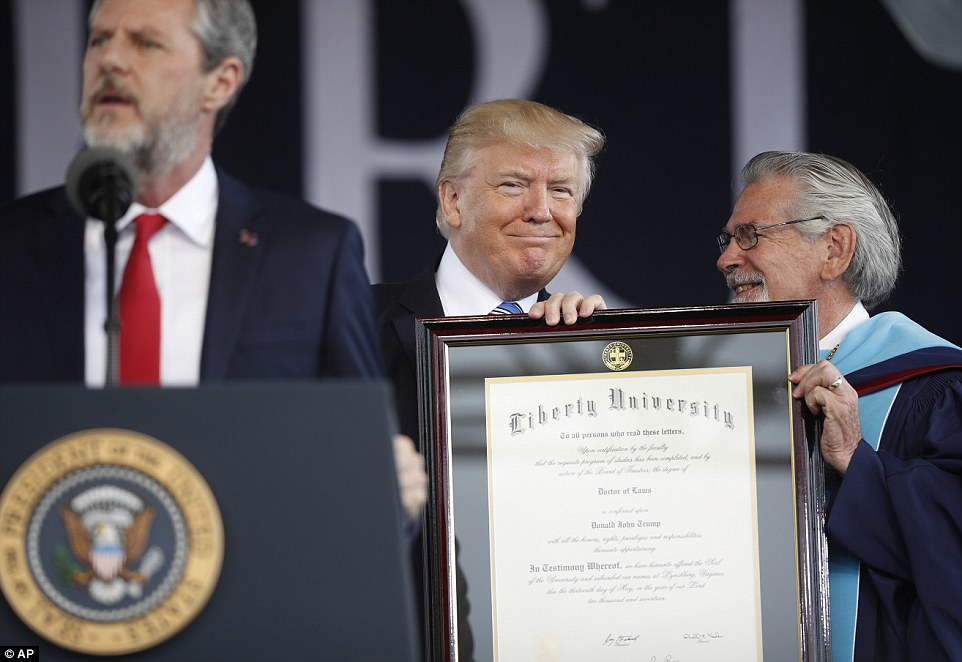'The more a broken system tells you that you're wrong, the more you must keep pushing forward,' Trump told the graduates. Trump is pictured with Falwell as he received an honorary degree from the university