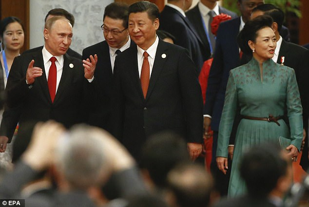 Chinese President Xi Jinping, his wife Peng Liyuan and Russian President Vladimir Putin arrive for the welcoming banquet for the Belt and Road Forum at the Great Hall of the People in Beijing, China, on Sunday