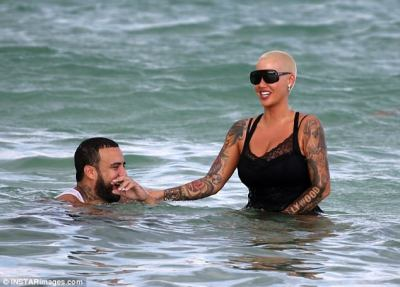 Fun in the sun: Amber and French couldn't stop smiling as they spent time together