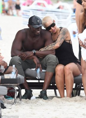 Hugging it out: The dancer was then seen embracing a very muscular mystery man on the beach
