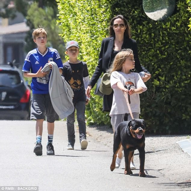 Young family: The actress joined ten-year-old Shiloh, and eight-year-olds Vivienne and Knox