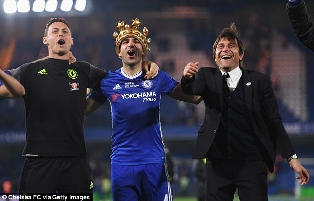 The Chelsea boss (r) celebrates with Cesc Fabregas (c) and Nemanja Matic (l) with the fans