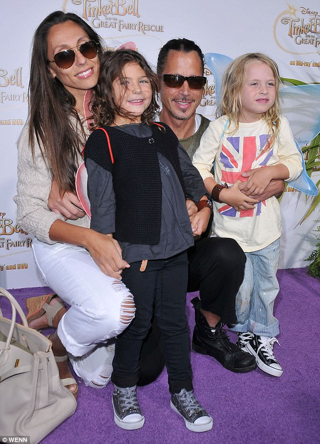 Sweet: They are parents to Toni, 12 and Christopher, 11 - pictured with his family in 2010
