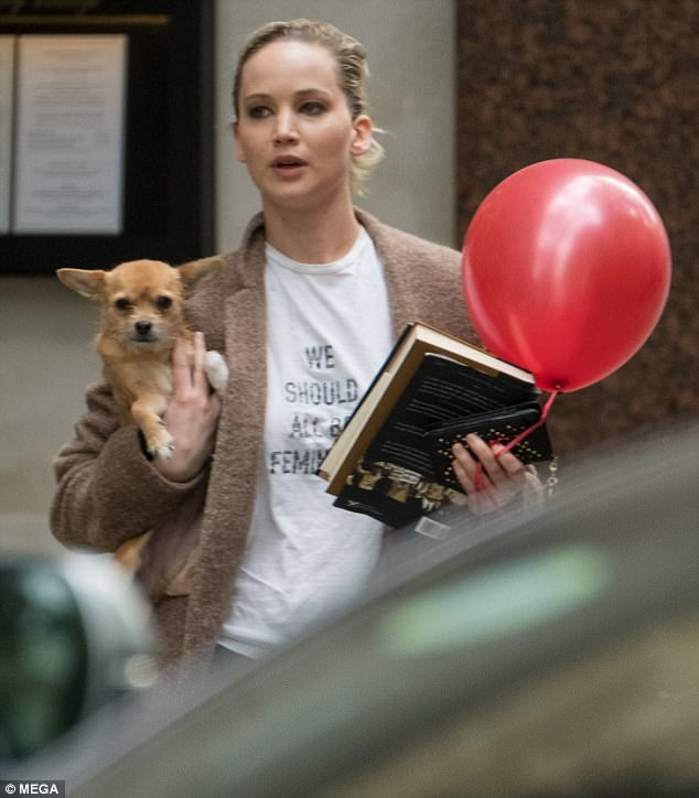 No worries: Jennifer looked carefree in her casual top, adding a warm taupe jacket with her hair pulled back into a bun