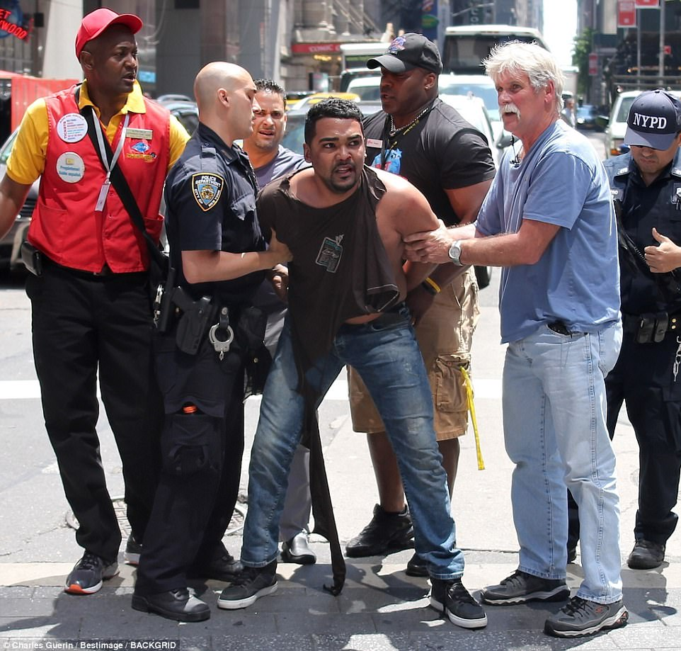 He was arrested at the scene moments later by NYPD officers after being stopped by a group of Good Samaritans which included a Planet Hollywood bouncer who tackled him to the ground and another man who tore off his shirt to ensure he was not wearing carrying any weapons