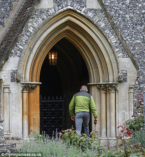 Men with walkie talkies were seen taking a look around the church and the surrounding gardens