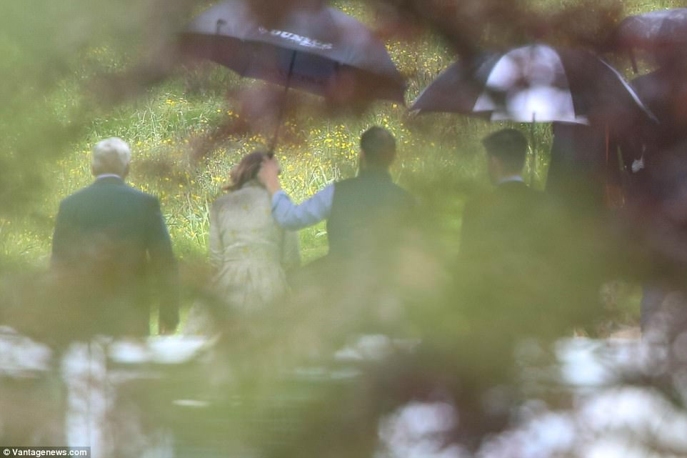 James Middleton was the perfect gentleman as he held an umbrella over his mother's head. James and Pippa are fiercely close siblings so he no doubt had a huge part to play in organising the event
