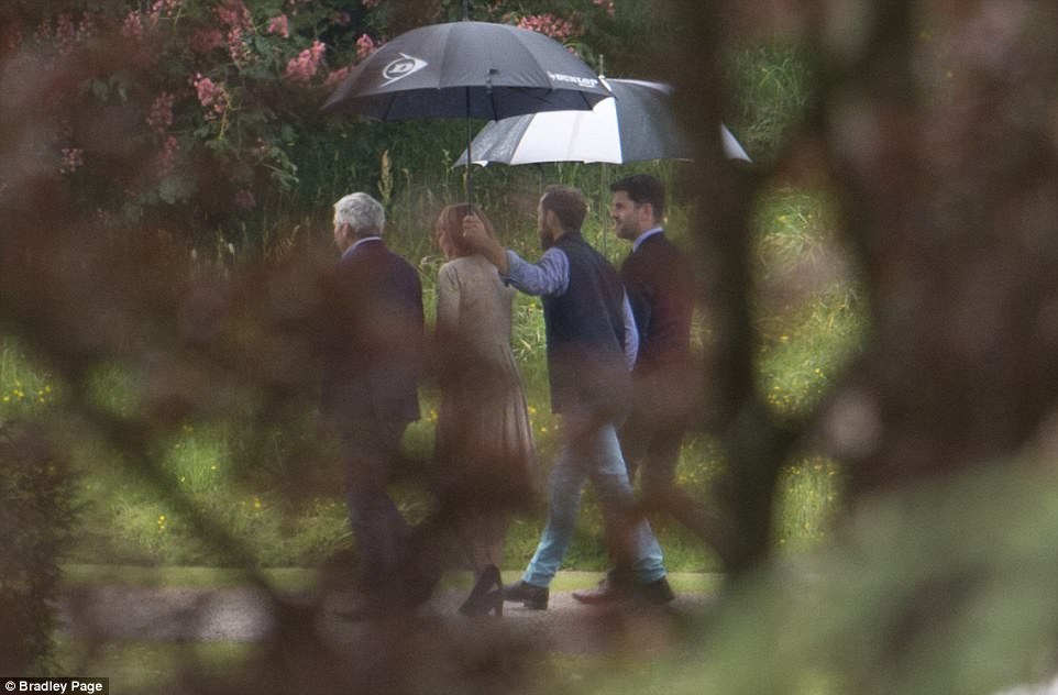 The bride's family, L-R, Carole, Michael and James Middleton, were seen arriving at the church for a rehearsal ahead of Pippa and James's wedding tomorrow with another male guest, right. The ceremony will take place at St Mark's Church with a reception being held back at the family mansion afterwards