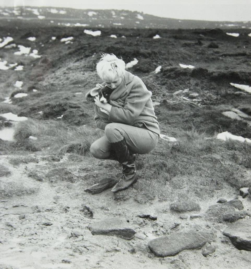 Among the most infamous of the pair's pictures was this one of Hindley crouching over the grave of one of their victims