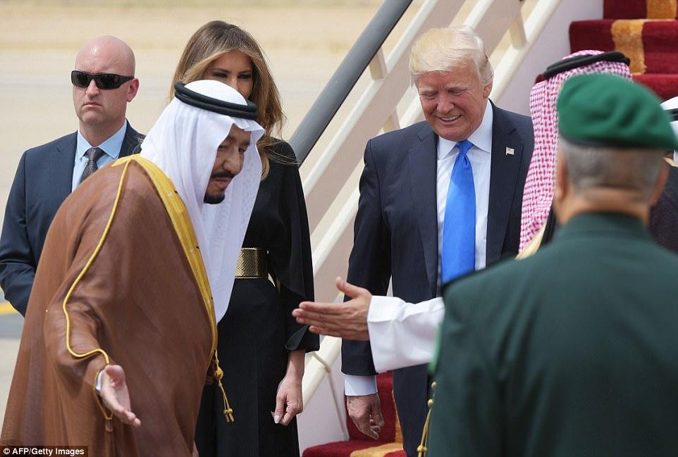 Saudi Arabia's King Salman bin Abdulaziz al-Saud (left) shows the way to US President Donald Trump and First Lady Melania Trump upon arrival at King Khalid International Airport in Riyadh