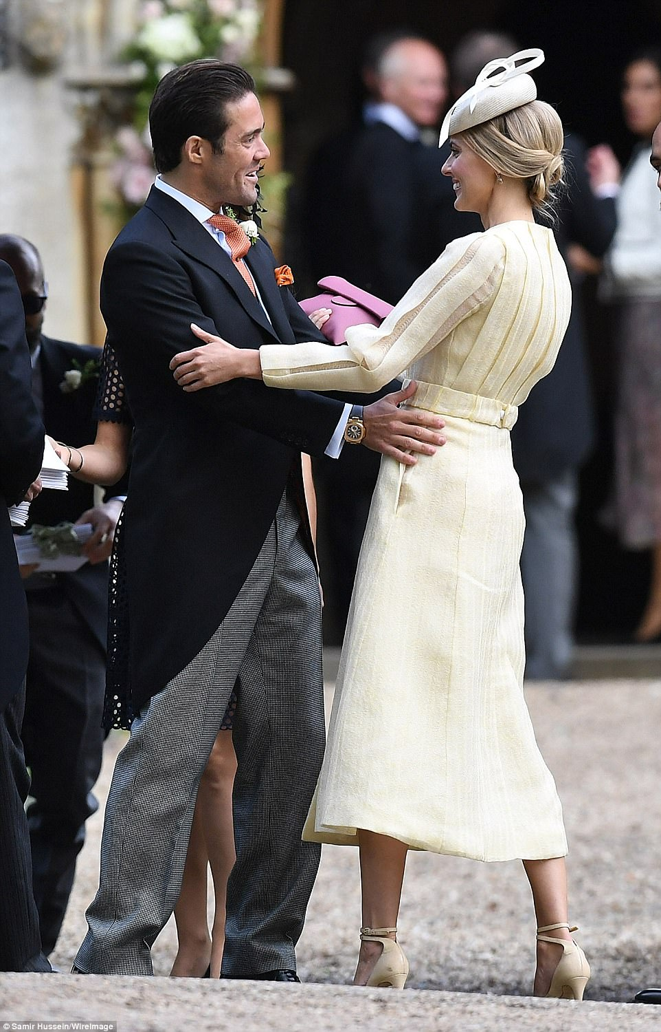 Spencer Matthews, brother of James Matthews, greets James Middleton's girlfriend Donna Air outside the church