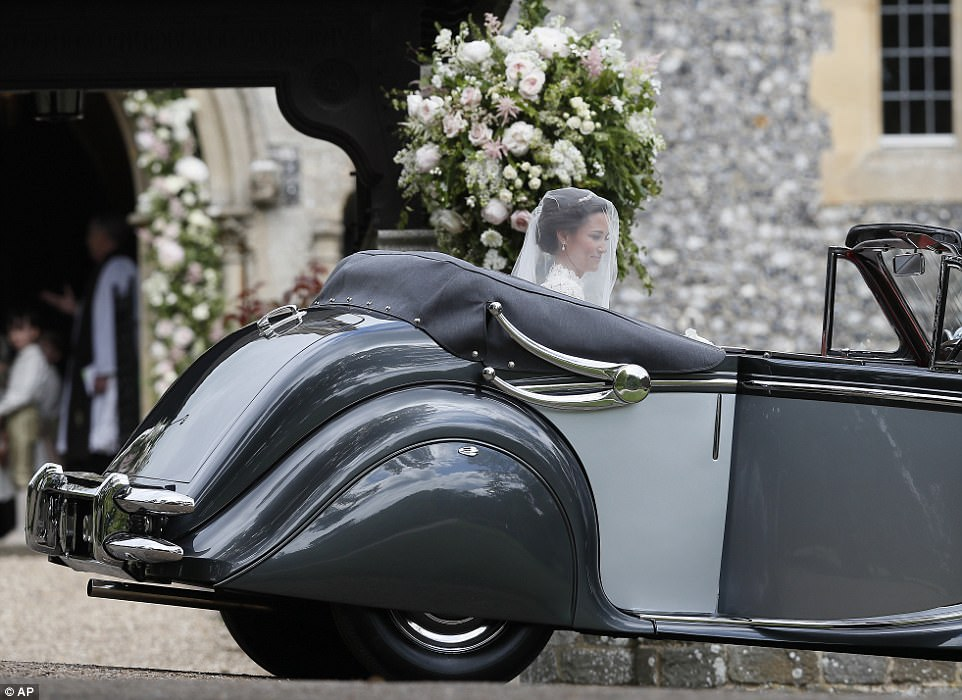 Pippa Middleton arrives for her wedding to James Matthews in a vintage car with her father