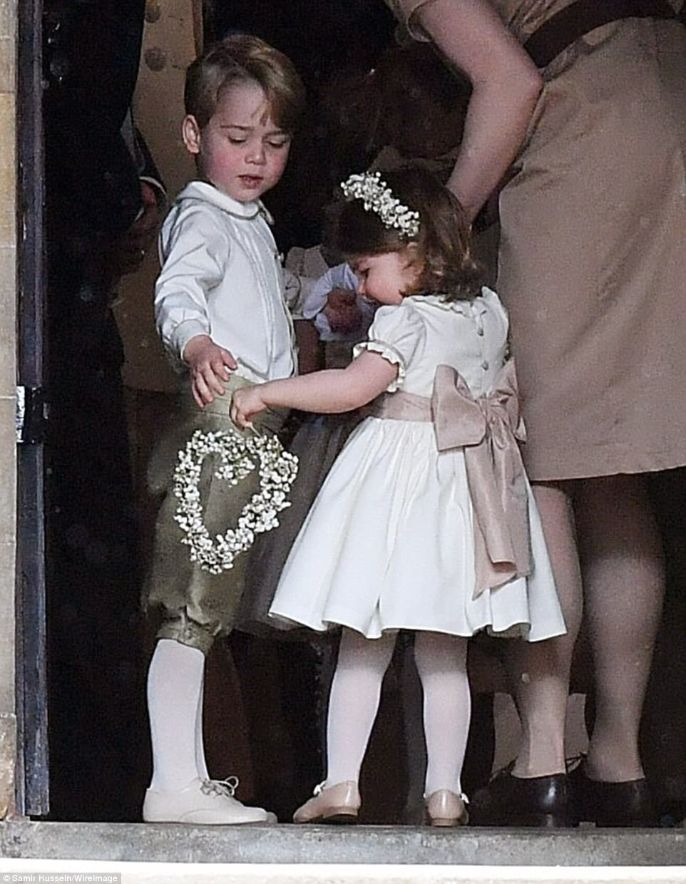 It may have been their aunt's big day but Prince George and Princess Charlotte managed to steal the limelight from Pippa Middleton as they served as page boy and bridesmaid at the society wedding of the year