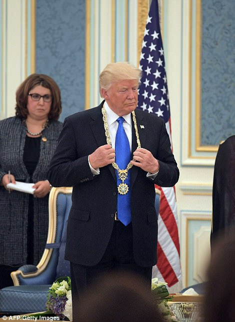 US President Donald Trump receives the Order of Abdulaziz al-Saud medal at the Saudi Royal Court in Riyadh on May 20