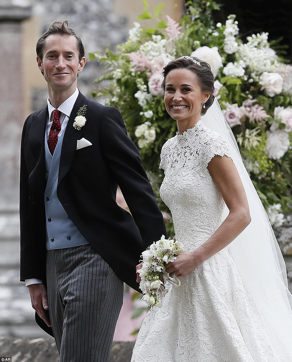 Pippa Middleton and James Matthews smiled for the cameras after their wedding at St Mark's Church in Englefield in front of 100 of their society friends