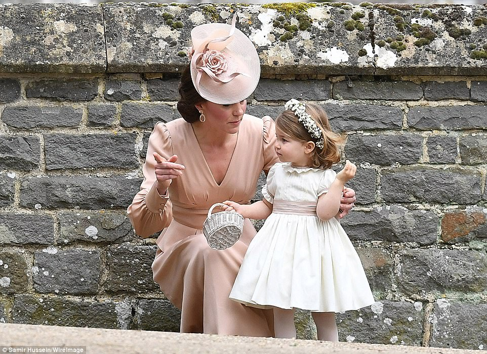 The Duchess of Cambridge crouched down to tend to her daughter, Princess Charlotte, who was a bridesmaid for Pippa