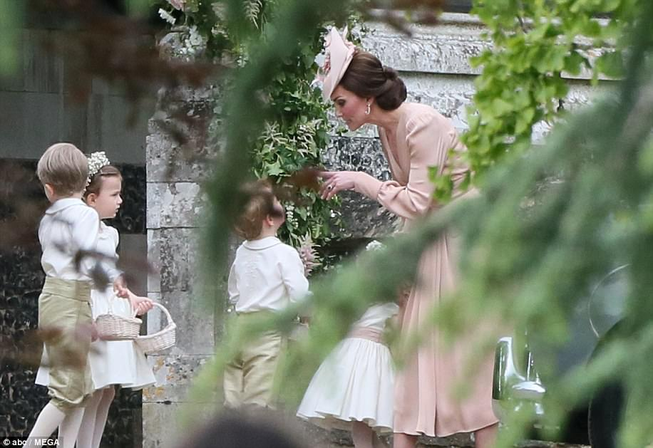Uh oh! The Duchess lost her cool as she told Prince George to quieten down after he descended into a tantrum outside the church following the service
