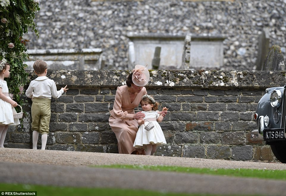 Kate was certainly a hands-on mother as she was left to care for her two children whilst her husband mingled with guests inside the church. Little Charlotte made a cherubic bridesmaid for Pippa today