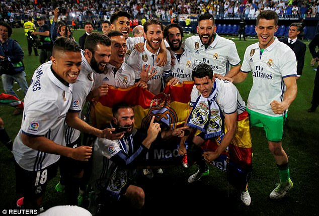 Real Madrid celebrate as a team as they prepare to receive their La Liga trophy