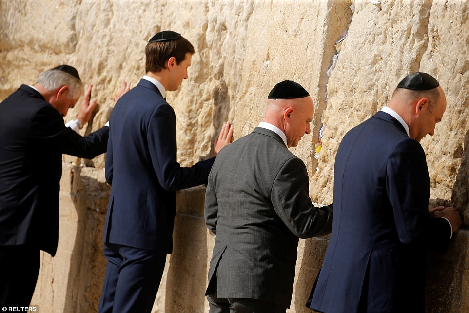 From left to right:Secretary of State Rex Tillerson, White House senior adviser Jared Kushner, National Security Adviser H.R. McMaster and chief economic advisor Gary Cohn leave notes at the Western Wall