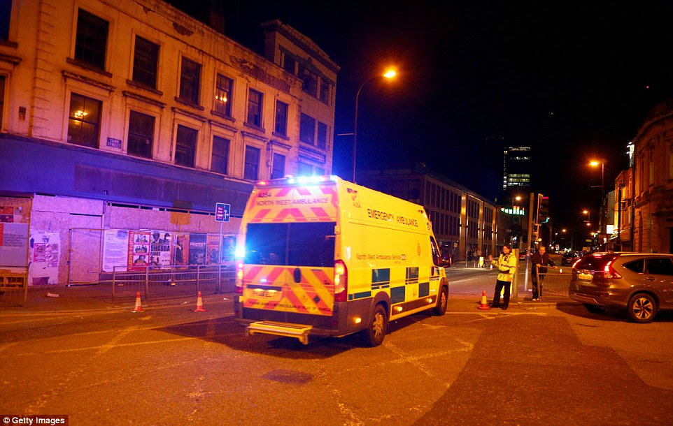 Armed officers surrounded the venue after the explosion at the end of a performance by US singer Ariana Grande