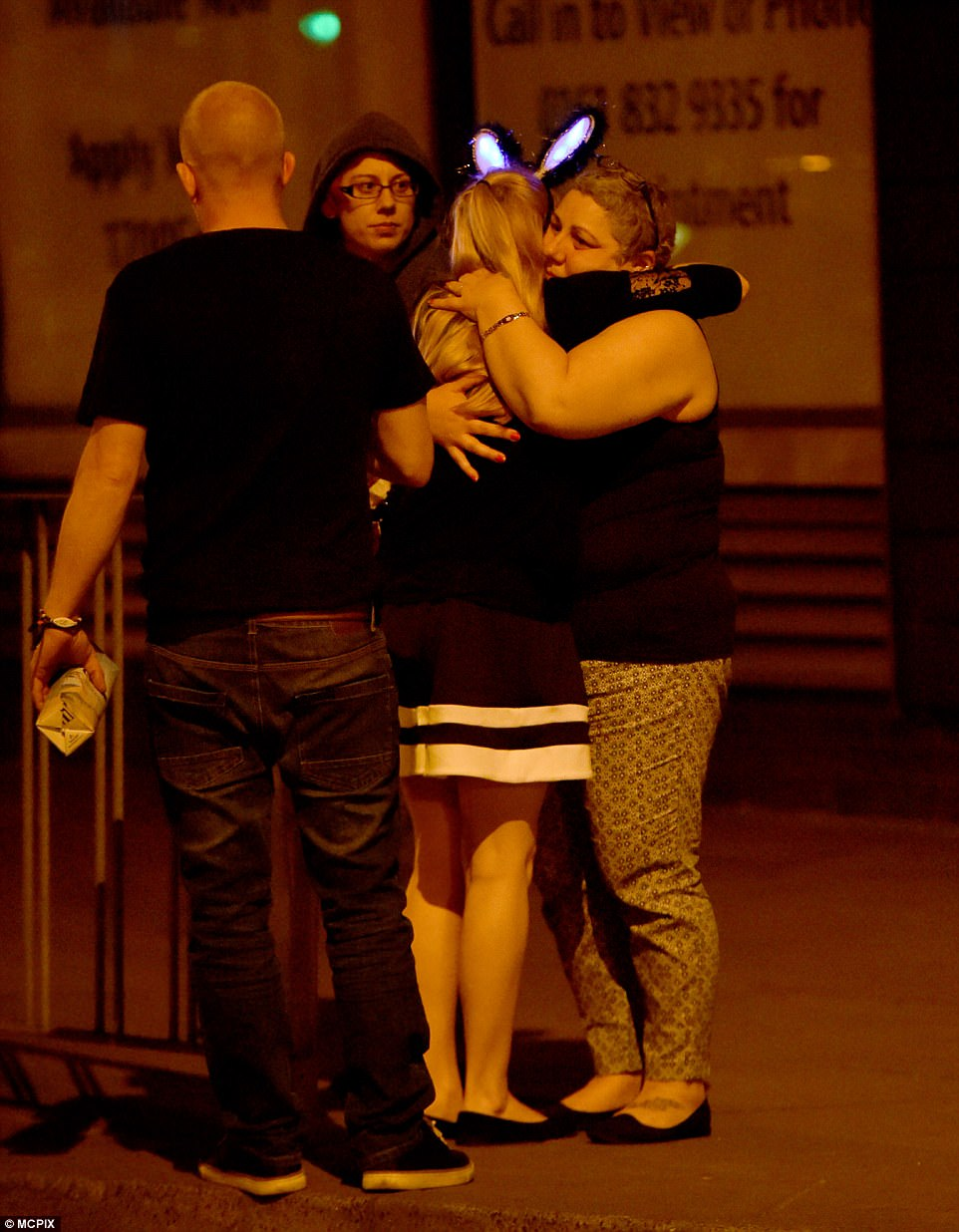 Friends consoled one another outside the venue after the suspected terror attack in Manchester tonight