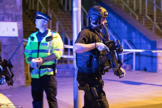 Armed police carrying assault rifles were quick to arrive at the scene. Police said they are treating the incident as terror-related 'until we know otherwise'