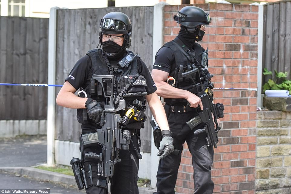 Security chiefs say SAS troops are ready to be deployed to any further terrorist acts. Pictured: Armed officers in Manchester