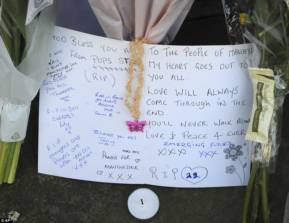 Cards left in memory of the victims were signed by local residents. This one read: 'Love will always come through in the end'