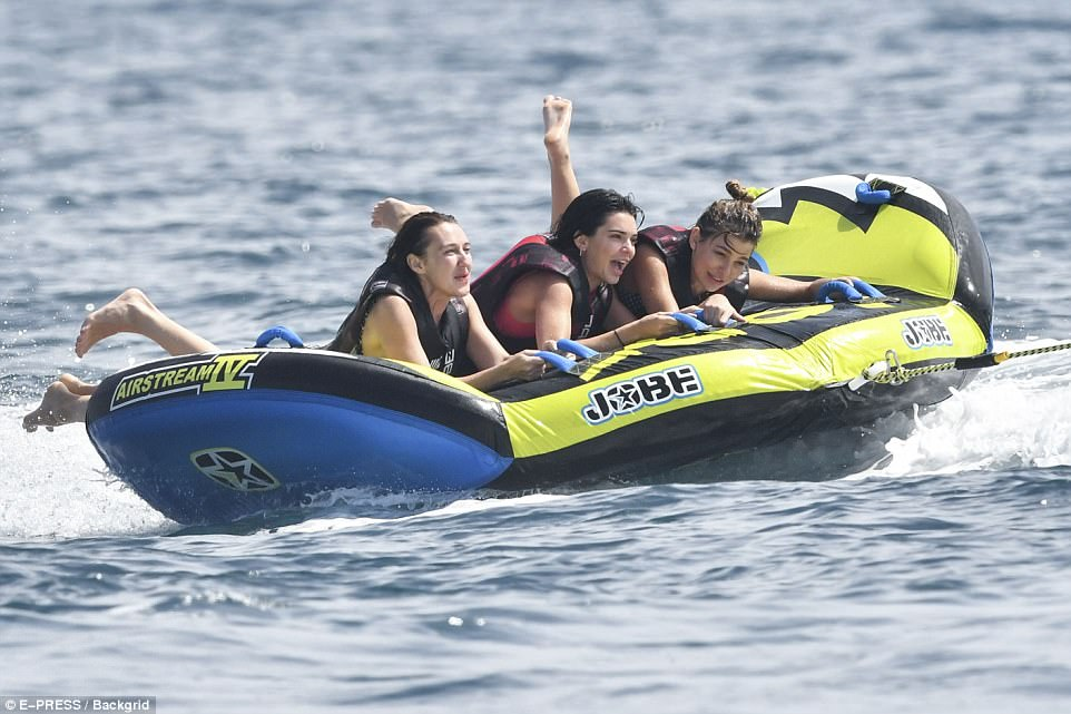 Fun in the sun! Kendall and Hailey held on tight as they were pulled through the rough seas on the banana boat
