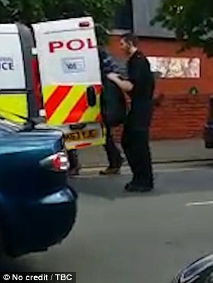 Footage shows officers arresting a 23-year-old man outside a Morrisons supermarket in Chorlton-Cum-Hardy, south Manchester this morning