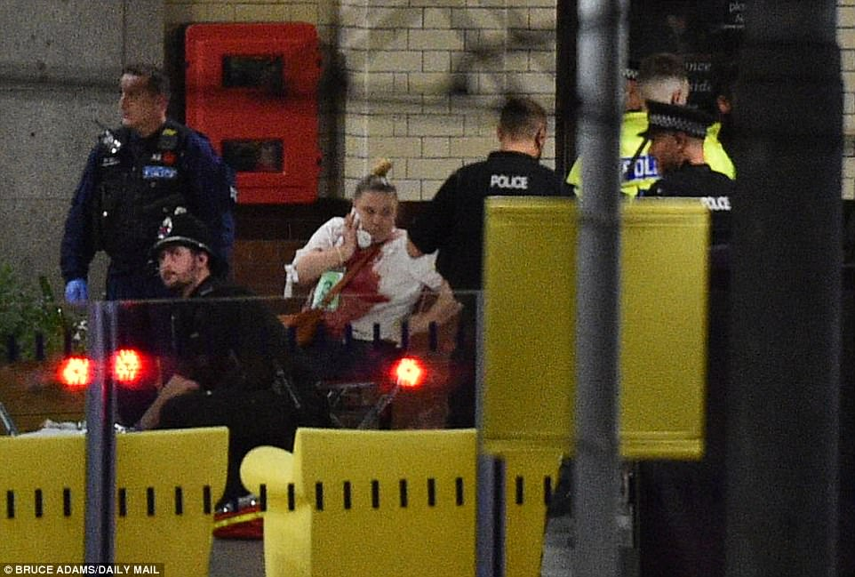 A woman spotted being helped by emergency services following the  terror attack in Manchester