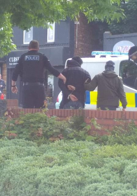 Armed officers arrested a man  in south Manchester today with police saying the action was linked to the attack