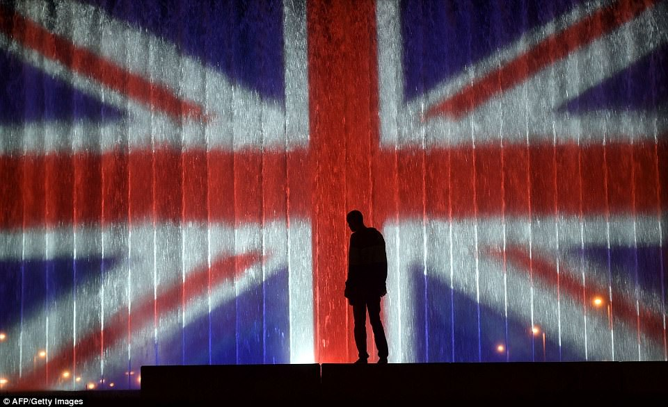 Stunning:A man stands in front of a fountain illuminated with the colours of the United Kingdom's flag in Zagreb, Croatia in support of the victims