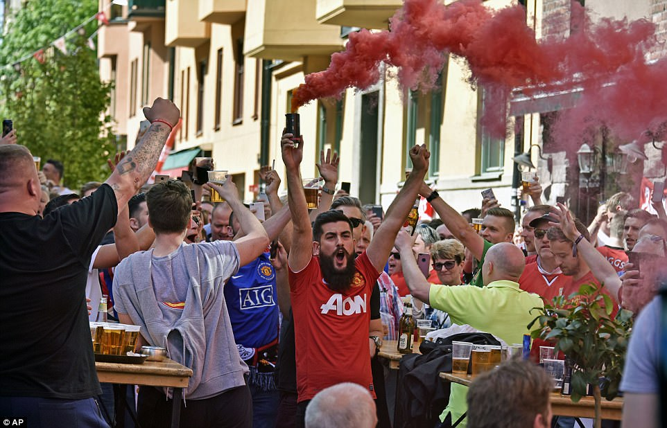Some United fans let off smoke flares and fireworks as they partied during the day before watching their team against Ajax